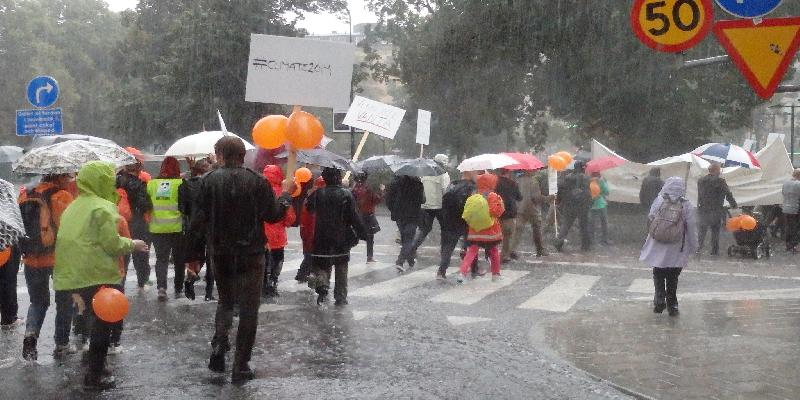 people march in the rain